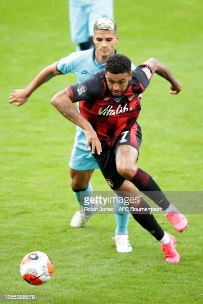 Erik Lamela of Tottenham Hotspur closes down Joshua King of Bournemouth during the Premier League match between AFC Bournemouth and Tottenham Hotspur...