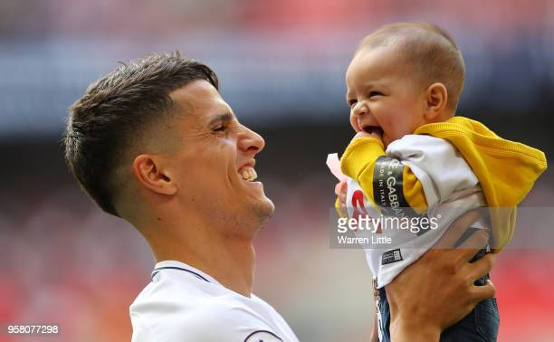 Erik Lamela of Tottenham Hotspur enjoys the lap of honour with his child after the Premier League match between Tottenham Hotspur and Leicester City...