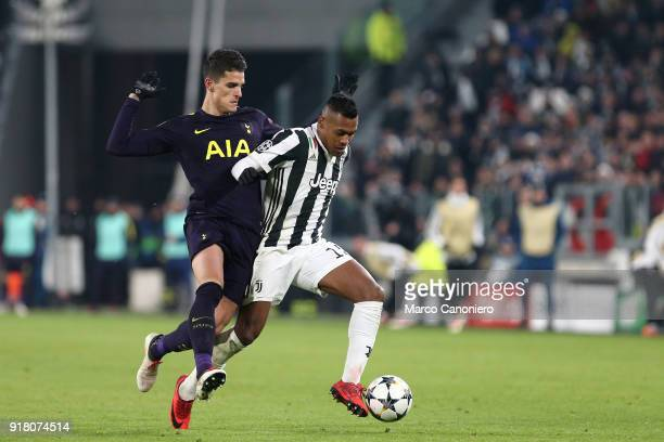 Erik Lamela of Tottenham Hotspur Fc and Alex Sandro of Juventus Fc in action during the UEFA Champions League round of 16 first leg match between...