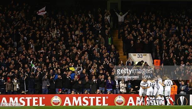 Erik Lamela of Tottenham Hotspur FC celebrates scoring the opening goal with his team mates during the UEFA Europa League group J match between...