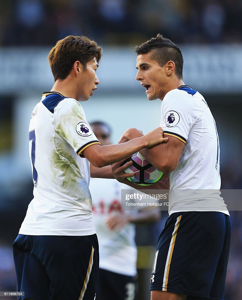 Erik Lamela of Tottenham Hotspur (R) grabs the ball off Heung-Min Son of Tottenham Hotspur (L) to take the penalty during the Premier League match between Tottenham Hotspur and Manchester City at White Hart Lane on October 2, 2016 in London, England.