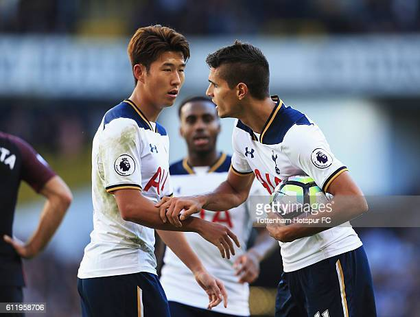 Erik Lamela of Tottenham Hotspur grabs the ball off HeungMin Son of Tottenham Hotspur to take the penalty during the Premier League match between...