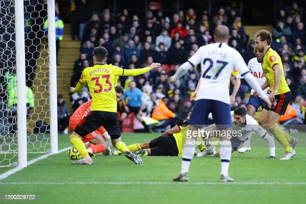 Erik Lamela of Tottenham Hotspur has hit shot cleared off the line by Ignacio Pussetto of Watford during the Premier League match between Watford FC...