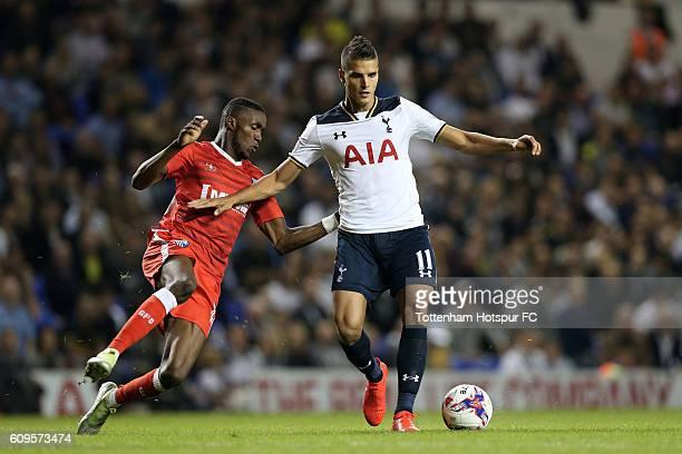 Erik Lamela of Tottenham Hotspur holds off Emmanuel Osadebe of Gillingham during the EFL Cup Third Round match between Tottenham Hotspur and...