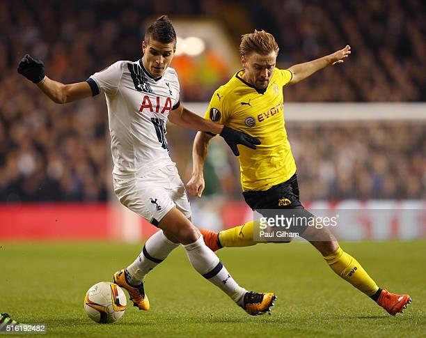 Erik Lamela of Tottenham Hotspur holds off Marcel Schmelzer of Borussia Dortmund during the UEFA Europa League round of 16 second leg match between...