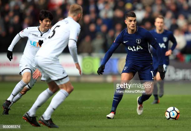 Erik Lamela of Tottenham Hotspur in action with Mike van der Hoorn Ki Sungyueng of Swansea City during the Emirates FA Cup Quarter Final match...