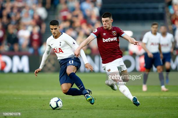 Erik Lamela of Tottenham Hotspur is challenged by Declan Rice of West Ham United during the Premier League match between West Ham United and...