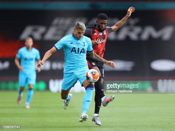 Erik Lamela of Tottenham Hotspur is challenged by Jefferson Lerma of AFC Bournemouth during the Premier League match between AFC Bournemouth and...
