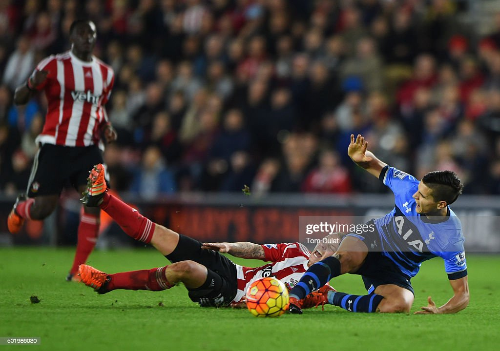 Erik Lamela of Tottenham Hotspur is challenged by Jordy Clasie of Southampton during the Barclays Premier League match between Southampton and Tottenham Hotspur at St Mary's Stadium on December 19, 2015 in Southampton, England.