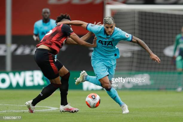 Erik Lamela of Tottenham Hotspur is challenged by Lloyd Kelly of AFC Bournemouth during the Premier League match between AFC Bournemouth and...