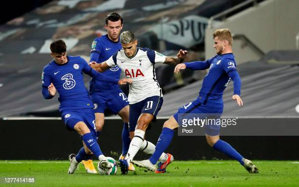 Erik Lamela of Tottenham Hotspur is challenged by Mason Mount and Timo Werner of Chelsea during the Carabao Cup fourth round match between Tottenham...