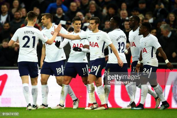 Erik Lamela of Tottenham Hotspur is congratulated by his teammates after scoring his side's second goal during the Emirates FA Cup Fourth Round...