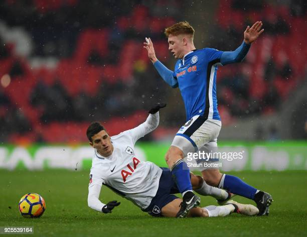 Erik Lamela of Tottenham Hotspur is fouled by Callum Camps of Rochdale during the Emirates FA Cup Fifth Round Replay match between Tottenham Hotspur...