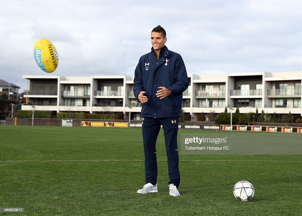 Erik Lamela of Tottenham Hotspur is seen with an aussie rule football during a Tottenham Hotspur player visit to the Hawthorn Hawks AFL team at Waverley Park on July 27, 2016 in Melbourne, Australia.