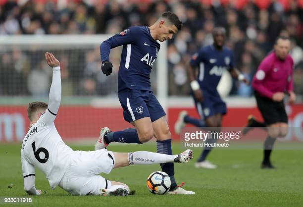 Erik Lamela of Tottenham Hotspur is tackled by Alfie Mawson of Swansea City during The Emirates FA Cup Quarter Final match between Swansea City and...