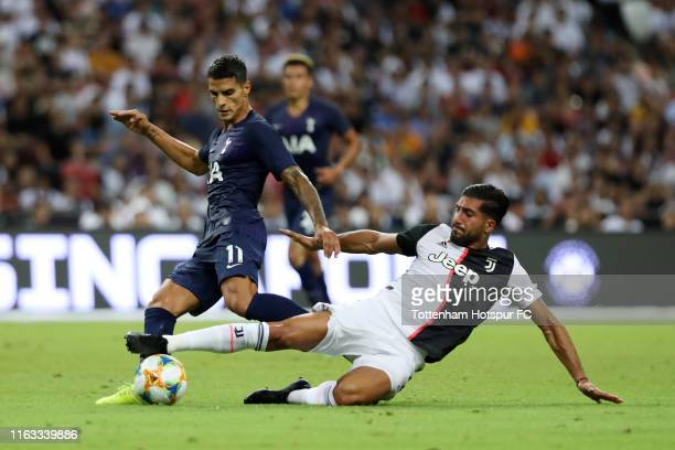 Erik Lamela of Tottenham Hotspur is tackled by Emre Can of Juventus during the International Champions Cup match between Juventus and Tottenham...