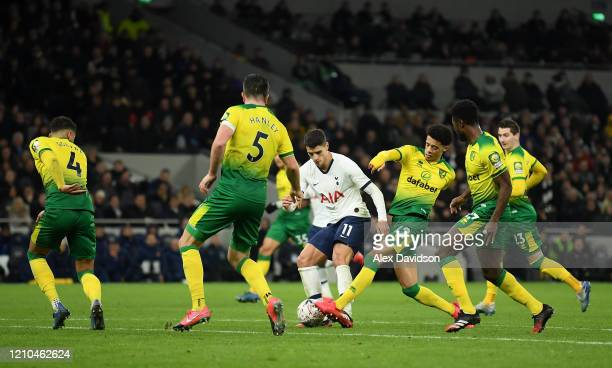 Erik Lamela of Tottenham Hotspur is tackled by Jamal Lewis of Norwich City during the FA Cup Fifth Round match between Tottenham Hotspur and Norwich...