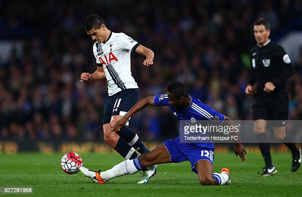 Erik Lamela of Tottenham Hotspur is tackled by John Mikel Obi of Chelsea during the Barclays Premier League match between Chelsea and Tottenham...