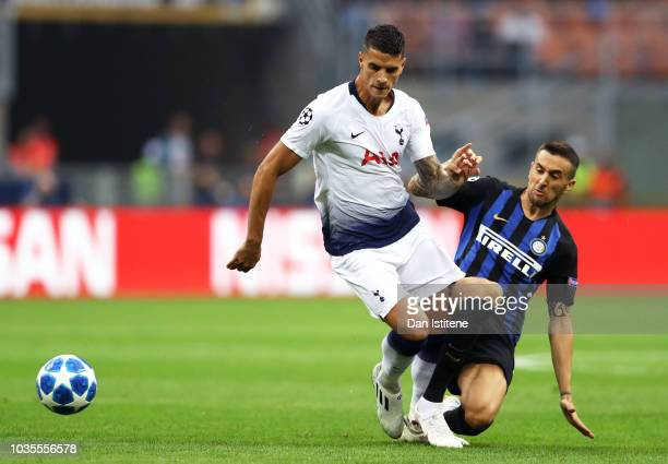 Erik Lamela of Tottenham Hotspur is tackled by Matias Vecino of Inter Milan during the Group B match of the UEFA Champions League between FC...