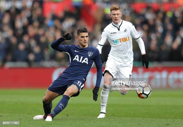 Erik Lamela of Tottenham Hotspur passes the ball under pressure from Samuel Clucas of Swansea City during The Emirates FA Cup Quarter Final match...