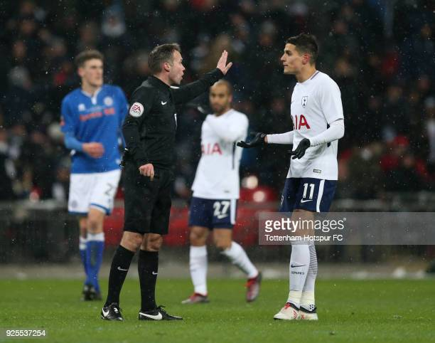 Erik Lamela of Tottenham Hotspur protests with Referee Paul Tierney after a HeungMin Son penalty was disallowed by VAR during the Emirates FA Cup...