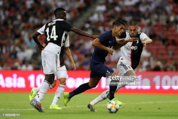 Erik Lamela of Tottenham Hotspur runs past Juventus defense during the International Champions Cup match between Juventus and Tottenham Hotspur at...