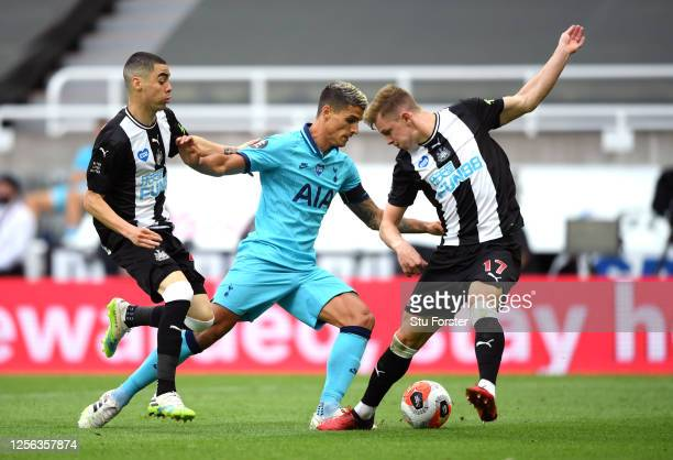 Erik Lamela of Tottenham Hotspur runs with the ball past Emil Krafth of Newcastle United during the Premier League match between Newcastle United and...