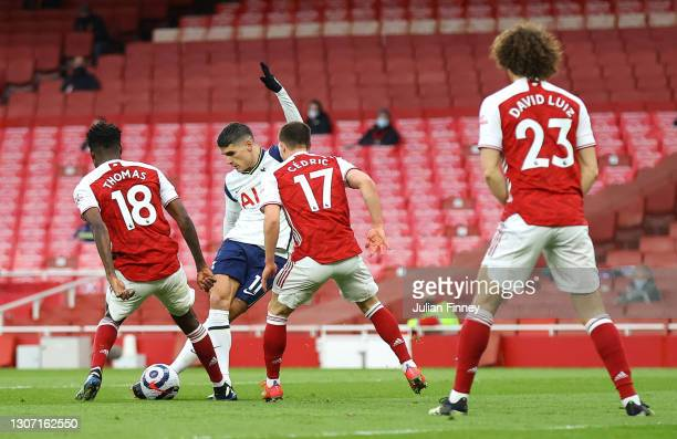 Erik Lamela of Tottenham Hotspur scores his side's first goal with a 'rabona' during the Premier League match between Arsenal and Tottenham Hotspur...
