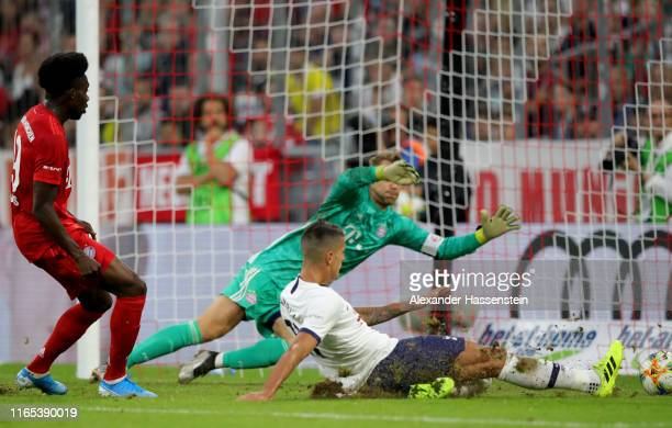 Erik Lamela of Tottenham Hotspur scores his team's first goal against Manuel Neuer of FC Bayern Muenchen and Alphonso Davies of FC Bayern Muenchen...