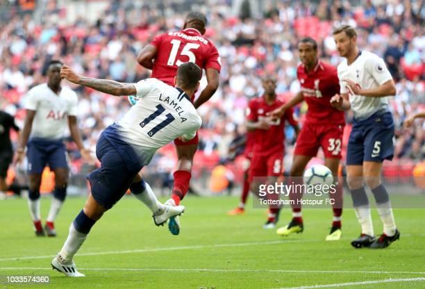 Erik Lamela of Tottenham Hotspur scores his team's first goal during the Premier League match between Tottenham Hotspur and Liverpool FC at Wembley...