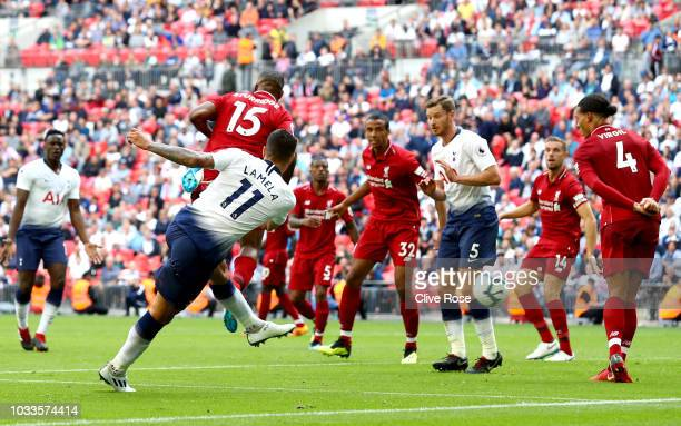 Erik Lamela of Tottenham Hotspur scores his team's first goal during the Premier League match between Tottenham Hotspur and Liverpool FC at Wembley...