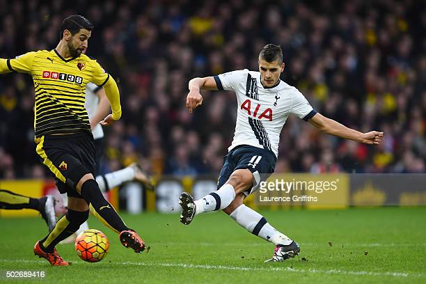 Erik Lamela of Tottenham Hotspur scores his team's first goal during the Barclays Premier League match between Watford and Tottenham Hotspur at...