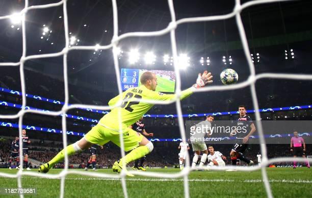 Erik Lamela of Tottenham Hotspur scores his team's fourth goal past Milan Borjan of Crvena Zvezda during the UEFA Champions League group B match...