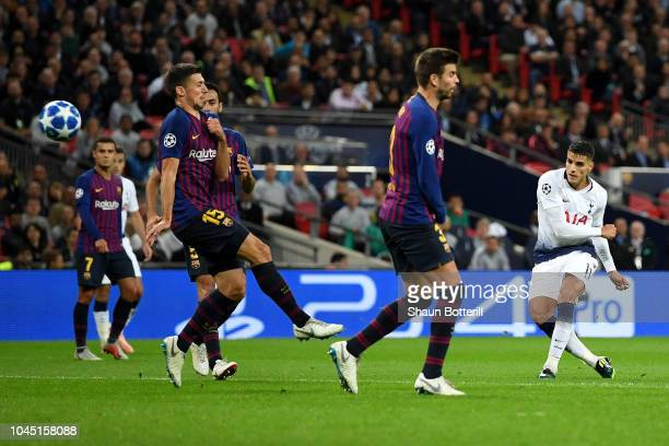 Erik Lamela of Tottenham Hotspur scores his team's second goal past Gerard Pique of Barcelona and Clement Lenglet of Barcelona during the Group B...