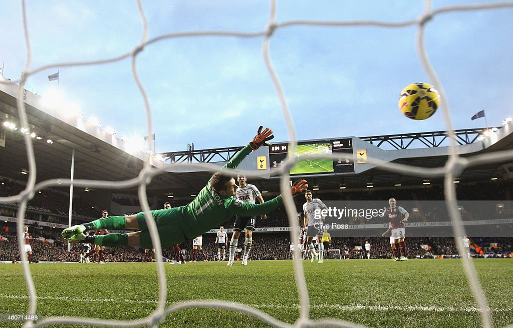 Erik Lamela (blocked) of Tottenham Hotspur scores past Thomas Heaton of Burnley during the Barclays Premier League match between Tottenham Hotspur and Burnley at White Hart Lane on December 20, 2014 in London, England.