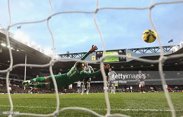 Erik Lamela of Tottenham Hotspur scores past Thomas Heaton of Burnley during the Barclays Premier League match between Tottenham Hotspur and Burnley...