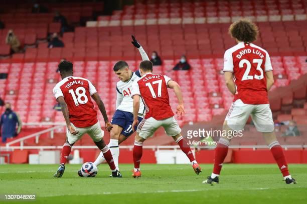 Erik Lamela of Tottenham Hotspur scores their side's first goal during the Premier League match between Arsenal and Tottenham Hotspur at Emirates...