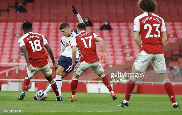 Erik Lamela of Tottenham Hotspur scores their side's first goal with a Rabona during the Premier League match between Arsenal and Tottenham Hotspur...