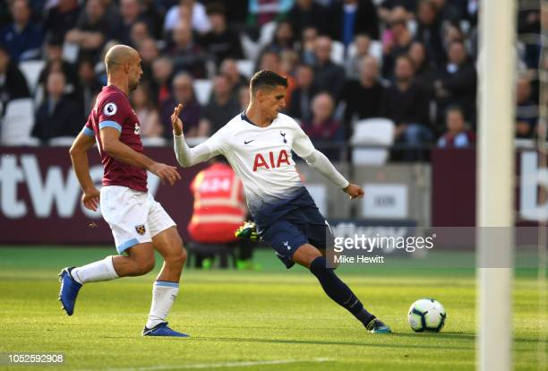 Erik Lamela of Tottenham Hotspur shoots while under pressure from Pablo Zabaleta of West Ham United during the Premier League match between West Ham...