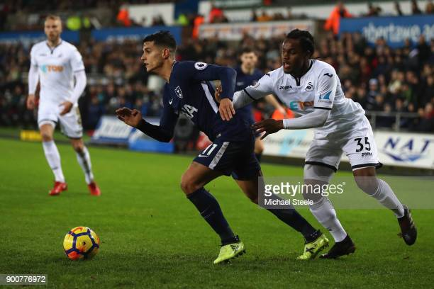 Erik Lamela of Tottenham Hotspur tracked by Renato Sanches of Swansea City during the Premier League match between Swansea City and Tottenham Hotspur...