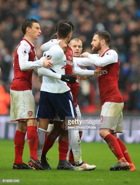 Erik Lamela of Tottenham Hotspur tries to confront Jack Wilshere of Arsenal as Laurent Koscielny and Shkodran Mustafi intervene during the Premier...