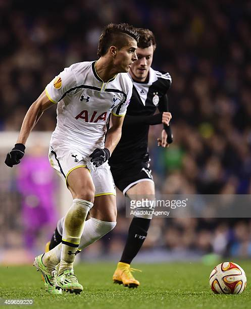 Erik Lamela of Tottenham Hotspur vies with Nikola Ninkovic of Partizan Belgrade during the UEFA Europa League group C football match between...