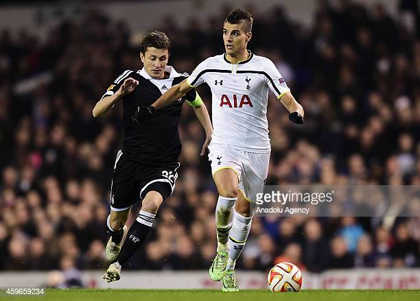Erik Lamela of Tottenham Hotspur vies with Sasa Ilic of Partizan Belgrade during the UEFA Europa League group C football match between Tottenham...