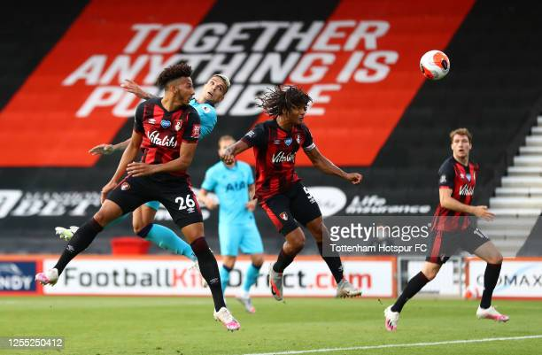 Erik Lamela of Tottenham Hotspur wins a header over Lloyd Kelly and Nathan Ake of AFC Bournemouth during the Premier League match between AFC...