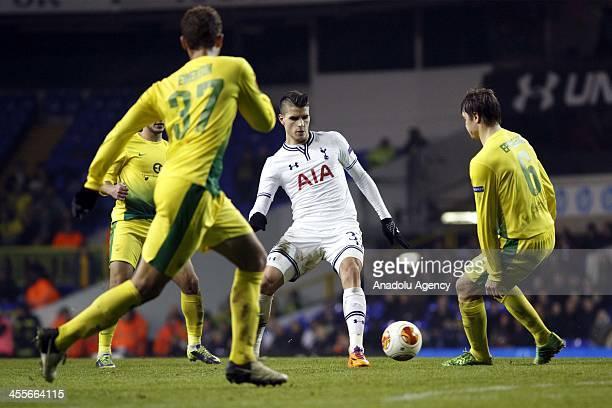 Erik Lamela of Tottenham in action with Alexandru Epureanu of FC Anji during the UEFA Erupe league Group K match at White Hart Lane in London,...