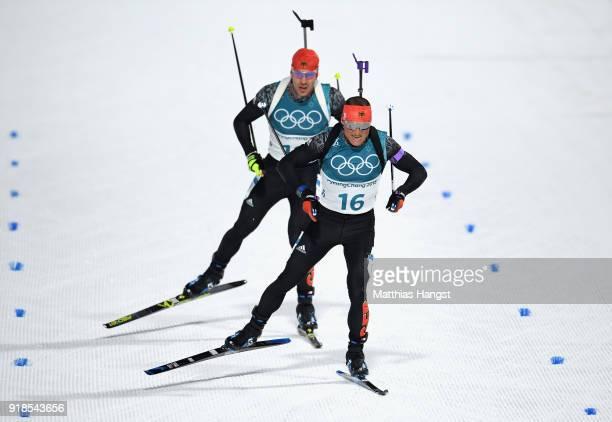 Erik Lesser and Arnd Peiffer of Germany finish during the Men's 20km Individual Biathlon at Alpensia Biathlon Centre on February 15 2018 in...