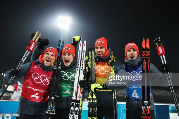 Erik Lesser Benedikt Doll Arnd Peiffer and Simon Schempp of Germany celebrate winning the bronze medal during the victory ceremony for the Men's...