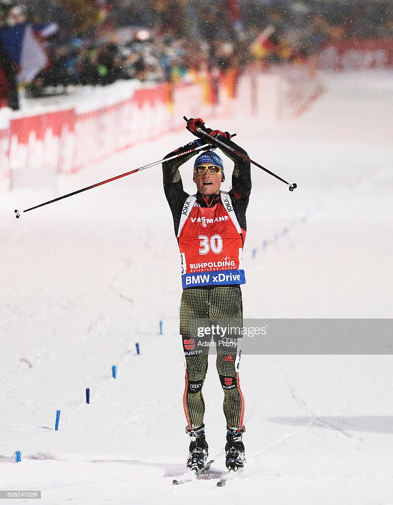 Erik Lesser of Germany celebrates victory as he crosses the finish line in the Men's 15km Biathlon race of the Ruhpolding IBU Biathlon World Cup on January 16, 2016 in Ruhpolding, Germany.