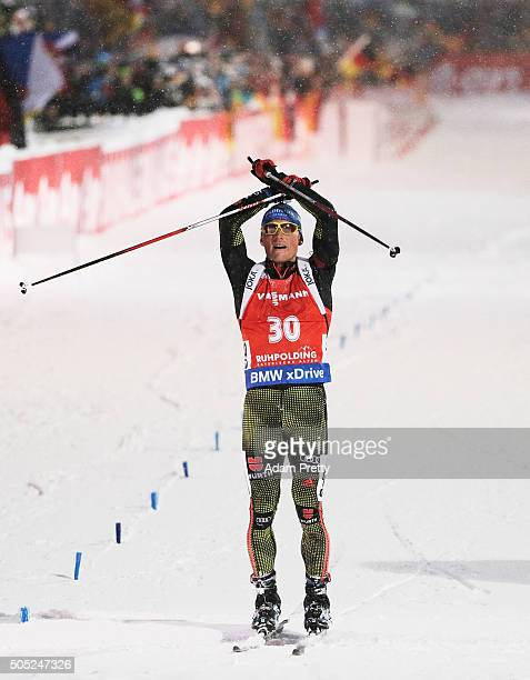 Erik Lesser of Germany celebrates victory as he crosses the finish line in the Men's 15km Biathlon race of the Ruhpolding IBU Biathlon World Cup on...