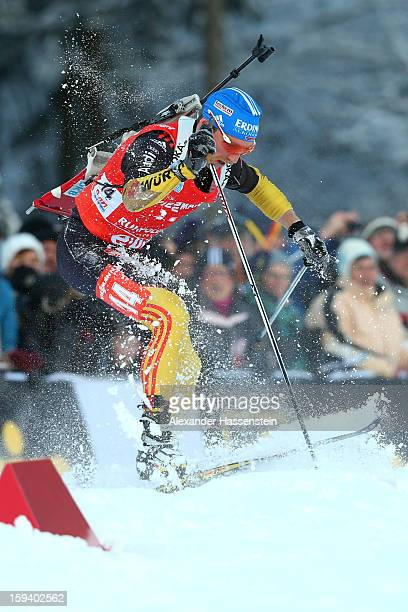 Erik Lesser of Germany chrashes at the men's 15km mass start event during the IBU Biathlon World Cup at Chiemgau Arena on January 13, 2013 in...